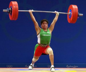(FILE) Picture taken in Sydney 18 September 2000 of Mexican Soraya Jimenez during the women's -58kg weightlifting of the 2000 Summer Olympics. Jimenez, the first Mexican to win gold in the Olympic Games, died on March 28, 2013 at the age of 36 of a heart attack, the Mexican Olympic Committee announced. AFP PHOTO / Patrick HERTZOGPATRICK HERTZOG/AFP/Getty Images ORG XMIT: